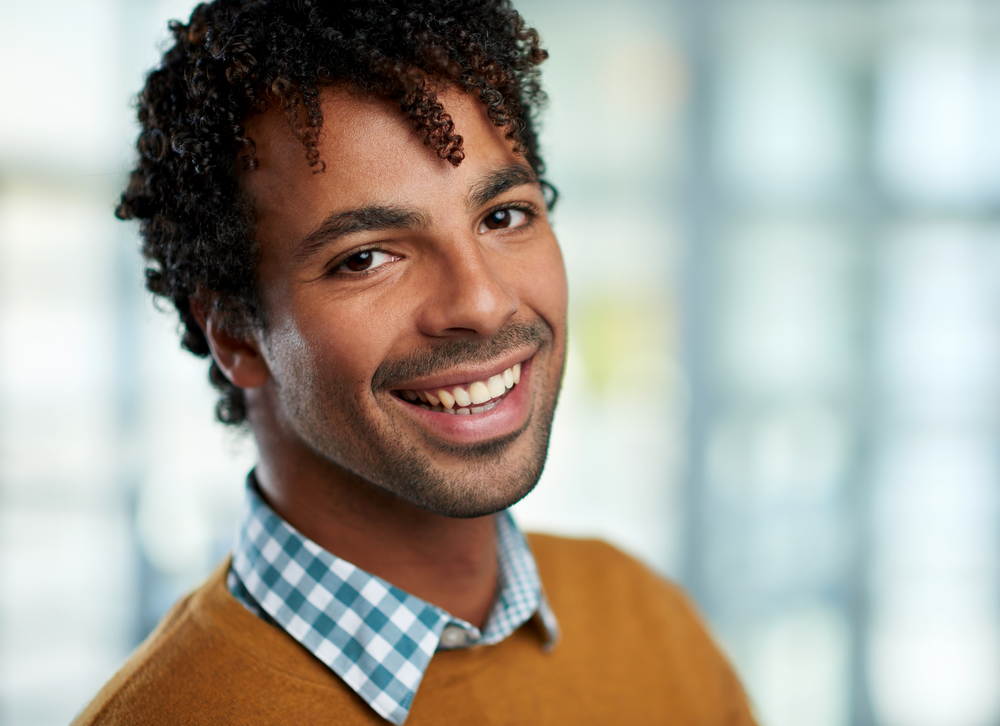 Horizontal headshot of an attractive african american businessman shot with shallow depth field.